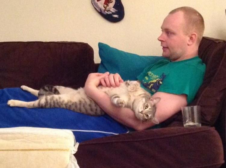 Boy spooning adorable cat